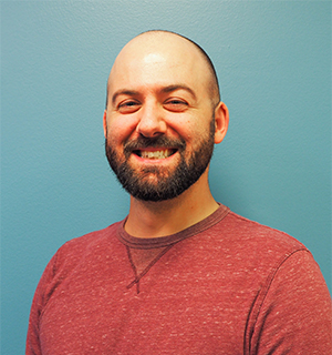 Headshot of Dj Tyson, Communications Manager